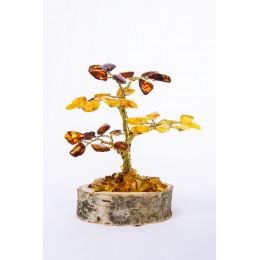 Boom uit amber op houten voet